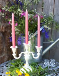 pink taper candles in candelabra Anglesey